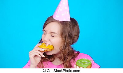 Young beautiful eating donut. Overeating concept - Young...