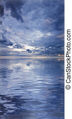 Beautiful water reflection of evocative cloudscape -...