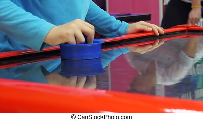 Children Play in the Air Hockey Game in the Children's...