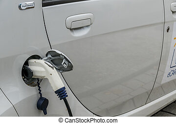 electric car on cradle - electric car at charging station....