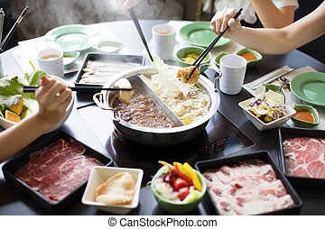 chinese foods Double flavor hot pot on the table