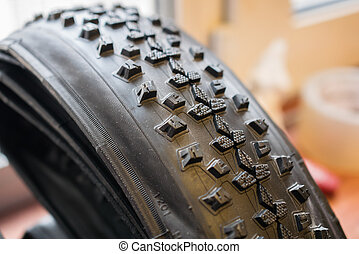 Photo of studded bicycle tire in garage