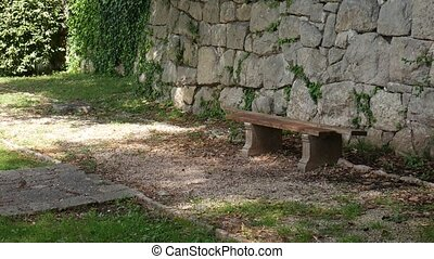 Bench in the park. Concrete bench with wooden Seats....