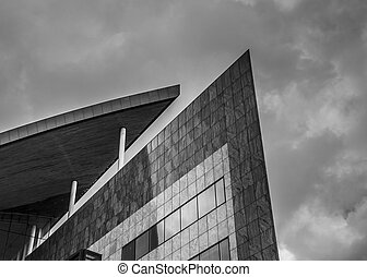 Strong lines and shapes of a high rise building, rendered in black and white to accentuate the shapes