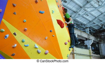 Climber On Artificial Climbing Wall - Climber Man On...