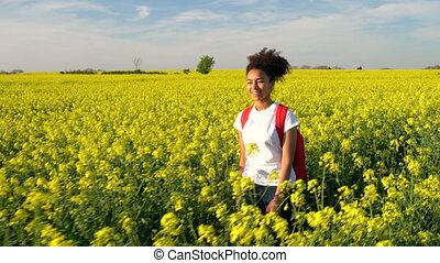 Mixed race African American girl teenager young woman hiking...