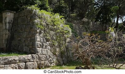 Ancient walls in the Balkans. The texture of the stone.