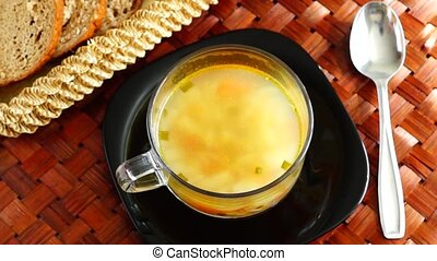 Put green onion in delicious soup - The hand lowers the...