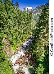 Waterfall Wodogrzmoty Mickiewicza in the Tatras, Poland,...