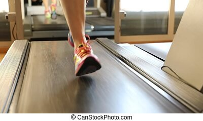 low view of treadmill run - Healthy lifestyle concept. Slow...