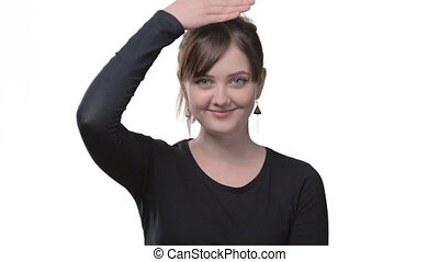 Young woman changes emotions on white background