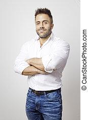 bearded man in blue jeans