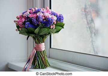 Wedding bouquet in pink and purple tones. Beautiful and...