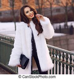 Lady in fur coat outdoors - Happy joyful girl in white fur...