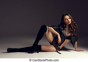 Sexy girl in lingerie, jacket and hessian boots - Fashion...
