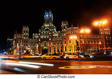 Cybele Palace at the Plaza de Cibeles at night in Madrid,...