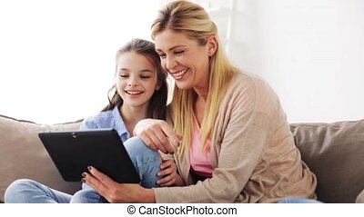 happy family with tablet pc at home - people, family and...