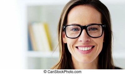 face of happy smiling middle aged woman in glasses - people,...