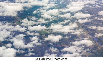 Look Outside of Airplane Window - View of ground and...