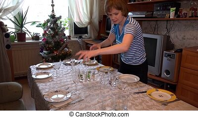 Woman covering the festive table. 4K. - Woman covering the...