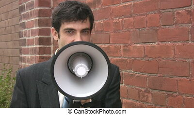 Megaphone businessman. 2 shots. - Man in suit talks to...