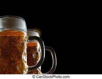 Two beer mugs - Two light beer mugs on black background