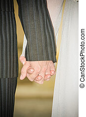 Wedding hands - Young married couple holding hands ceremony...