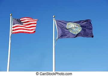 New Hampshire state flag and USA national flag waving under...