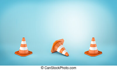Three striped traffic cones placed on blue background and...