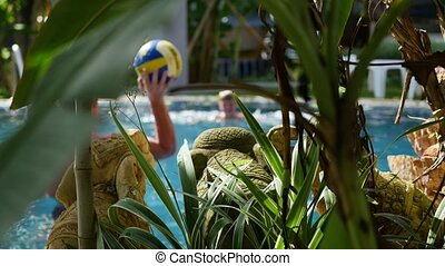 a guy and a kid playing ball in the pool. sports outdoors -...