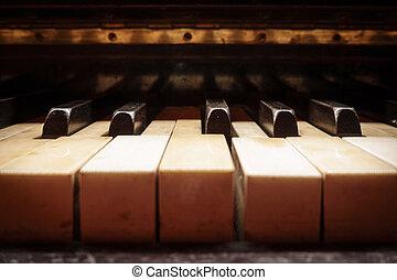 Closeup of antique piano keys - Antique piano keys closeup