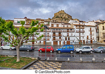 Impressive view of medieval village Morella with castle and cars