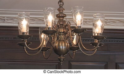 Chandelier zoom-in. 2 shots. - Zooming in to a beautiful...