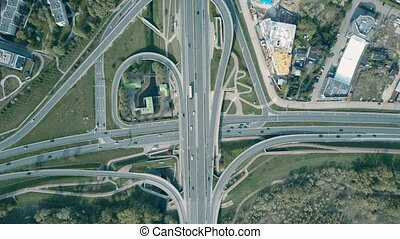 Aerial shot of road junction in an industrial area, top down...