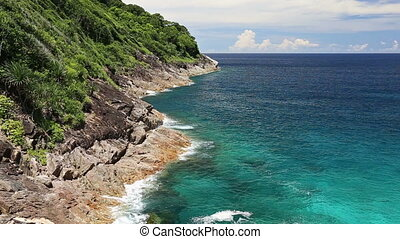 Waves water splash stone turquoise beach at view point andaman sea Koh Tachai Island Thailand