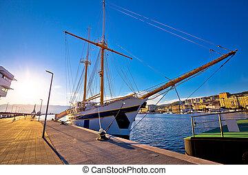 Wooden boat in Rijeka waterfront harbour, Kvarner bay,...