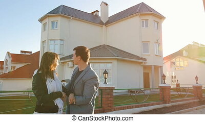 Couple in front of new house - Portrait of happy family in...