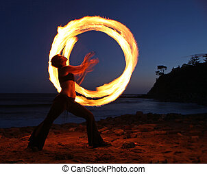 Firedancer along the beach at dusk