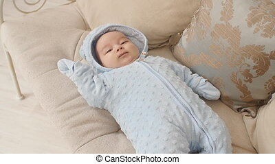 Cute baby boy lying on the couch - Cute baby lying on the...