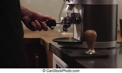 Barista works with a coffee machine.
