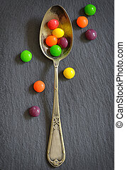 Colorful jelly candies in spoon