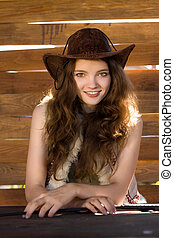 portrait of beautiful smiling cowgirl in stetson