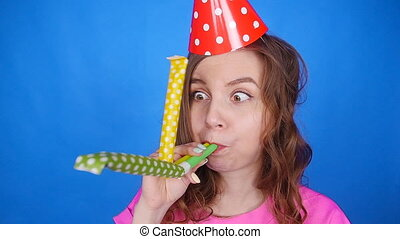 Funny woman celebrating birthday and hooting with horn -...