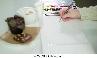 Woman artist painting watercolor paints 4k