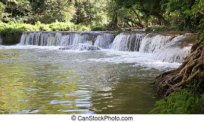 Paradise Waterfall in forest at in Namtok Chet Sao Noi...