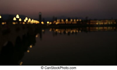 Night city is defocused with nice bokeh reflect from water