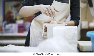Close up of woman making gypsum - Close up of a woman in an...
