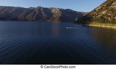 Speed Dinghy at high speed sailing on the sea. Kotor Bay in Mont