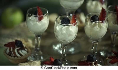 Whipped cream in a glass. Sweet dessert in glass with...