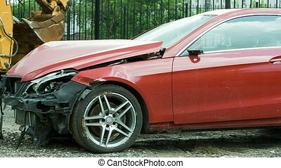 New red luxury car crashed by a drunk driver